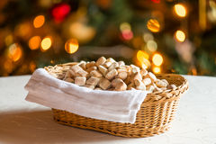 Kuciukai pastries. Basket of traditional Lithuanian Kuciukai pastries served on Christmas Eve with decorative lights in background royalty free stock images