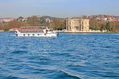 Kucuksu Kasri and touristic boat in Instanbul, Turkey Royalty Free Stock Photo