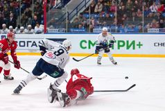 A. Kudinov (44) fall down on ice Stock Photos