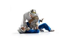 Kudo-Kämpfer sind das Kämpfen lokalisiert stockbild