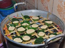 Kue Apem. Cakes made from rice flour wrapped in jackfruit leaves and steamed royalty free stock image