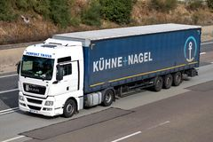 Kuehne + Nagel truck on motorway. Kuehne + Nagel International AG is a global transport and logistics company based in Schindellegi, Switzerland royalty free stock photos
