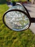 Kugel de vidro em Metallhalterung imagem de stock