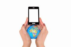 Kugel und Telefon in zwei Händen Lizenzfreie Stockfotografie
