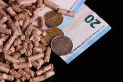Kugeln und das Geld stockbilder