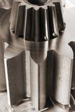 kuggedetaljen gears mekaniskt Royaltyfria Bilder