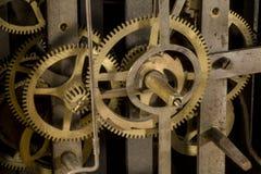 Kugghjul av en klocka arkivfoton