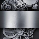 Kugghjul i en metallram Arkivfoto