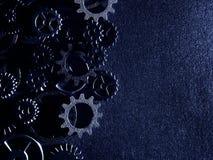 Kugghjul med texturerad bakgrund arkivfoto