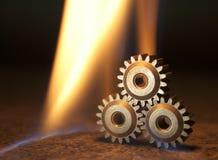 Kugghjul och brand Royaltyfria Bilder