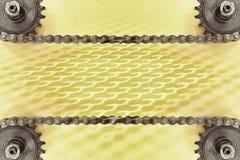 Kugghjul och dubbel kedja på gul bakgrund med den geometriska modellen Fotografering för Bildbyråer
