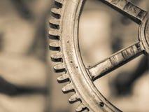 Kugghjulet ett kugghjul flyttar världen Fotografering för Bildbyråer