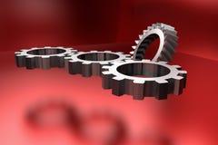Kugghjulhjul på röd glänsande bakgrund Royaltyfri Fotografi