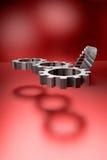 Kugghjulhjul på röd glänsande bakgrund Royaltyfri Bild
