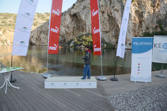 Kuguarhändelsen kör sjön - Aten, Grekland royaltyfria bilder