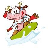 Kuh, die auf eine Milchwelle surft Stockfotos