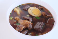 Kui-jab. Paste of rice flour in brown soup. Royalty Free Stock Photos