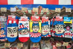 Kuidaore Taro souvenirs at Dontonbori, Osaka. OSAKA, JAPAN - NOV 20, 2016 - Kuidaore Taro souvenirs at Dontonbori, Osaka. Kuidaore Taro is one of the city`s most royalty free stock images