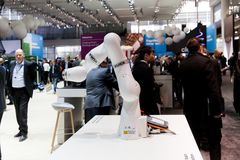 Kuka industrial robot hand in manufacturing industry on exhibition Cebit 2017 in Hannover Messe, Germany royalty free stock photos