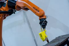 Kyiv, Ukraine - November 22, 2018: KUKA robot hand. KUKA robot arm with Scansonic Laser Brazing stock image