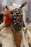 Kuker festival Bulgaria. Pernik, Bulgaria - January 25, 2014: Unidentified boy with traditional Kukeri costume are seen at the the International Festival of the Royalty Free Stock Image