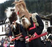Kukeri dans Shiroka Laka, Bulgarie Photographie stock
