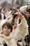 """Kukeri, kids mummers perform rituals with costumes and big bells on international festival of masquerade games """"Surva"""". Kukeri, kids mummers perform rituals Stock Photography"""