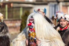 Kukeri maskeradfestival Arkivfoton