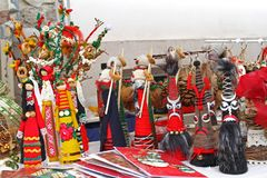 Kukeri and mummers dolls for Christmas and New year. Christmas decorationwallpaper. Handmade toys for Happy holidays. Handmade mum royalty free stock photography
