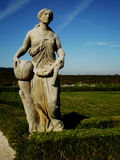 Statue woman with ball. Statue on Kuks - park, one of lot of statue Stock Photos