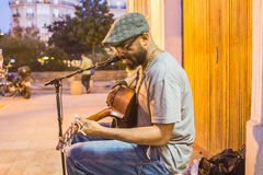 Kuku, folk musician, plays in front of shops on the Left Bank in Royalty Free Stock Images