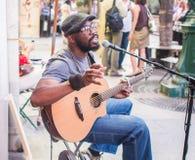 Kuku, itinerant folk musician, playing outside Shakespeare and C Stock Photo
