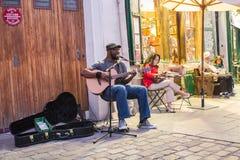 Kuku, itinerant folk musician, plays outside Shakespeare and Com Royalty Free Stock Photo