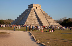 Kukulcan Temple of Chichen Itza in the Sunset with Large Group of People Royalty Free Stock Photo