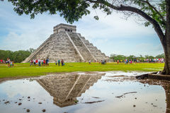 Kukulkan pyramid in Chichen Itza, Yucatan. CHICHEN ITZA, MEXICO - JULY 12, 2011: Uknown people visiting Kukulkan pyramid in Chichen Itza, Yucatan. Kukulkan Stock Photos