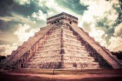 Kukulkan Pyramid (el Castillo) at Chichen Itza, Yucatan, Mexico. Color graded view of Kukulkan Pyramid (el Castillo) at the archaeological site of Chichen Itza Stock Photo
