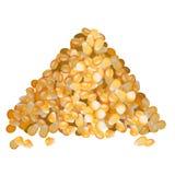 Kukurydzani ziarna wypiętrzają bocznego widok na białym tle Fotografia Royalty Free
