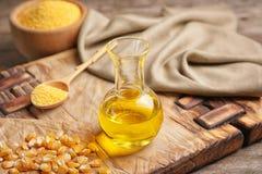 Kukurydzany olej, nasiona i mąka na pokładzie, Zdjęcie Stock