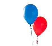 Kulöra ballonger på en vit bakgrund Arkivbilder
