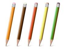 Kulöra blyertspennor royaltyfri illustrationer