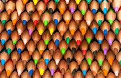 kulöra blyertspennor för sortimentbakgrundsfärg Fotografering för Bildbyråer