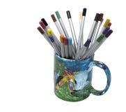 Kulöra blyertspennor i en koppfärg Royaltyfri Bild