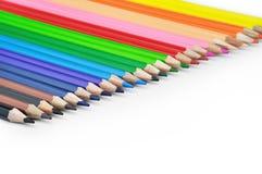 Kulöra blyertspennor i en rak Lineup Royaltyfria Foton