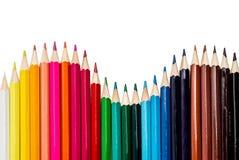 Kulöra blyertspennor som gör en våg arkivbild