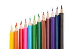 Kulöra blyertspennor som isoleras på vit Fotografering för Bildbyråer