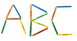 kulöra crayons för abc Arkivbilder