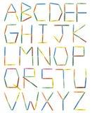 kulöra crayons för alfabet royaltyfri fotografi