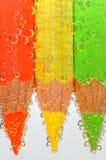 Kulöra crayons med bubblar royaltyfri foto