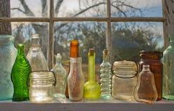 Kulöra flaskor Fotografering för Bildbyråer