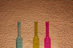 Kulöra flaskor Arkivbild